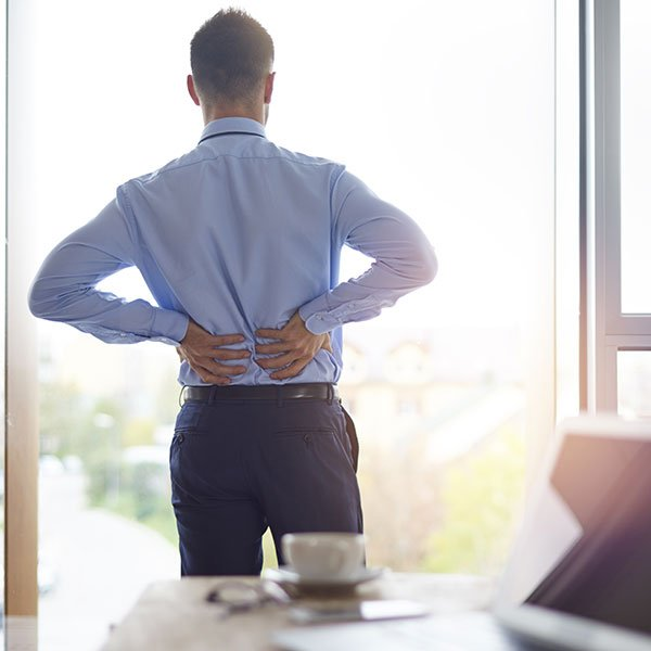 West Texas Chiropractor back pain of business person